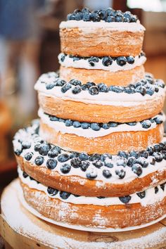 wedding cake with blueberries - photo by Veronica Varos Photography http://ruffledblog.com/chic-autumn-wedding-in-pennsylvania
