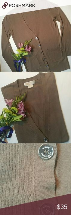 "Michael Kors light chocolate brown cardigan Michael Kors light chocolate cardigan with signature MK silver buttons with 2 pockets. Perfect for transitioning to the cooler fall weather. Slight pilling but overall EUC Armpit to armpit 18"" Length 28"" MICHAEL Michael Kors Sweaters Cardigans"
