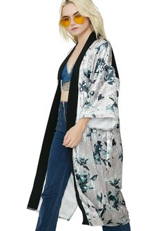 Lady Lily Floral Velvet Kimono the flowers bloom fer yew everywhere yew go, bb. Wander the fields in this kimono that features a super soft beige velvet construction, open front design with black trim, and a blue floral pattern all over.