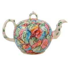 Important English Saltglazed Stoneware Teapot  England  circa 1760  An important English saltglazed stoneware teapot painted with a marbled patte