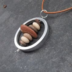 Beach stone necklace  pebble necklace with up cycled PC hard drive circle
