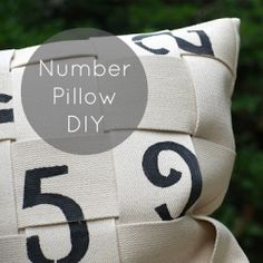 Tutorial: Take some belting and black fabric paint and make this cute, vintage-looking number pillow!