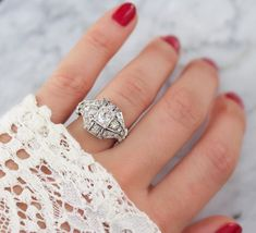 Edwardian Diamond Engagement Ring with old mine cut diamonds and old European cut diamods in a unique platinum setting! The Belle ring from Victor Barbone Jewelry!