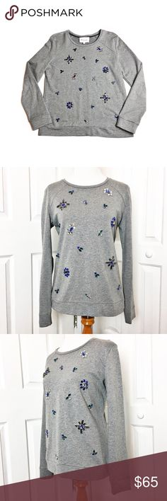 """Two by Vince Camuto Jeweled Baseball Sweatshirt Adorable gray sweatshirt adorned in jewels that appear to be bees and flowers.  Sweatshirt is gorgeous and can be dressed up or down.  No missing or loose stones.  Material is made of 74% cotton and 26% polyester.  Measurements laid flat: bust 20"""", and length from top of shoulder to hem 26"""". Two by Vince Camuto Tops Sweatshirts & Hoodies"""