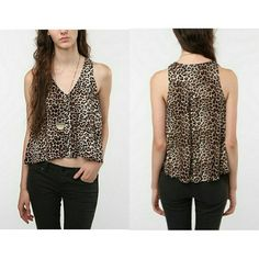 FINAL PRICE [Urban Outfitters] Leopard Tank Top Loose-fitting leopard cropped tank from Sparkle & Fade. Cute black buttons running down the front. Gently used, in great shape. I loved layering it over high-waisted bottoms and doing a front tuck.  ::NO TRADES:: Urban Outfitters Tops Tank Tops