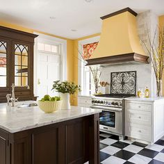 Checkerboard marble floors and sunflower-yellow walls enliven this formal kitchen! http://www.bhg.com/kitchen/styles/dream-kitchens/ultimate-kitchens/?socsrc=bhgpin050915popofcolorkitchen&page=3
