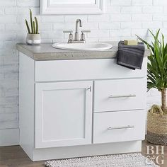 Countertops Invite the industrial trend into your bathroom with this gorgeous concrete vanity countertop. - Invite the industrial trend into your bathroom with this gorgeous concrete vanity countertop. We show you how easy it is! Diy Bathroom Vanity, Best Bathroom Vanities, Bathroom Vanity Lighting, Bathroom Furniture, Kitchen Furniture, Diy Furniture, Bathroom Ideas, Guys Bathroom, Warm Bathroom