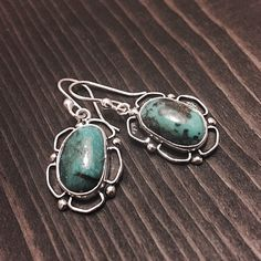 """Sterling Silver & Chrysocolla Earrings Stamped """"Ster"""".   This is not a stock photo. The image is of the actual article that is being sold  Sterling silver is an alloy of silver containing 92.5% by mass of silver and 7.5% by mass of other metals, usually copper. The sterling silver standard has a minimum millesimal fineness of 925.  All my jewelry is solid sterling silver. I do not plate.   Hand crafted in Taxco, Mexico.  Will ship within 2 days of order. Jewelry Earrings"""