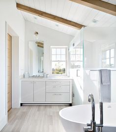 Bathroom with wooden accents, a shower, and a freestanding bathtub