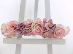 This crown is a mix of cream pink roses and purple mauve. It features roses and cherry blossom. I think pink and mauve go along well.  Mulberry paper