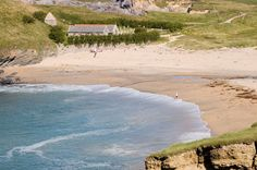 """St Winwalloe """"Church of the Storms"""" at Gunwalloe / Church Cove. In legend, the detached tower marks the site of a hermit's cell. Cornwall England, England Uk, Places In Cornwall, Cornwall Beaches, Tourist Info, South West Coast Path, English Countryside, Beautiful Beaches, Beautiful World"""