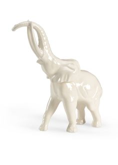 This elephant statue is made with euro ceramic and features a white glaze…