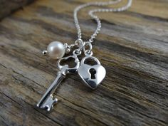 Key Necklace and Pearl. Key to My Heart in Sterling Silver . Heart-lock Necklace. Gift for Her . Pearl Necklace. $24.80, via Etsy.