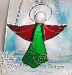My new Christmas Angel by MoreThanColors on Etsy, Love her shop. Added to my holiday tradition of 1new stained glass ornament ea. year.