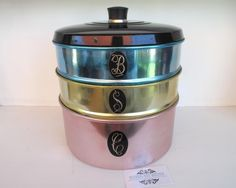 SOLD by NBV - more vintage finds added daily. Set of 3 harlequin stacking anodised Modelmaid canisters by Jason (Australia). Set contains pastel pink cake canister, lemon scones canister & blue biscuit canister with a black lid & bakelite knob. Writing on the lettering is in excellent condition, anodised colours very good with minimal scratches, c1950. A great set to add to any retro kitchenalia collection.
