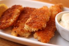 Easy Homemade Fish Sticks - 1/2 lb filet of firm white fish (tilapia, cod,halibut) 3 Tbs. flour, 2 eggs, 1 cup  panko (breadcrumbs) salt & pepper, 4-5 Tbs. veg oil, for frying.  Serves 2 -3 adults or 4 - 5 children.