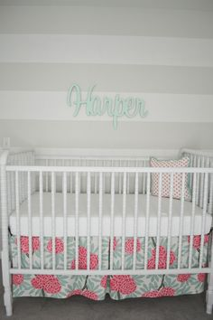 Beautiful modern floral crib skirt - pairs perfectly with the name above the crib!