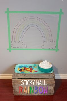 Sticky Wall Rainbow - Contact paper, tissue paper and cotton ball clouds.