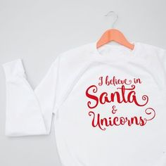 Santa And Unicorns Women's Sweatshirt Jumper. Shop Christmas Jumpers now.