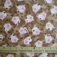 New. Pig in Mud Fabric to sew.  This print has pigs (adorable little pigs) tossed on a brown mud looking background.  This is a playful and wonderfully animated