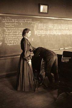 A school teacher lashing a boy student over a desk, Menomonie, Wisconsin, 1905.