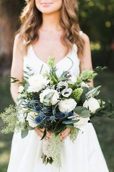 Boho greenery wedding bouquet with thistle: http://www.stylemepretty.com/new-york-weddings/oakdale/2017/01/11/classic-navy-greenery-wedding/ Photography: Ashley Caroline - http://ashley-caroline.com/