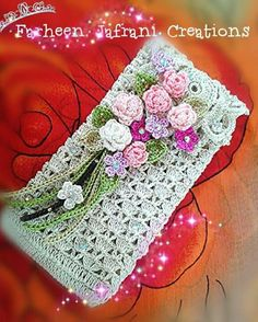 Crochet beaded clutch with flowers