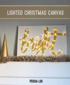 DIY Lighted Canvas for Christmas - Last year for Christmas, I wanted to create a large display for the shelf above our entertainment center that said