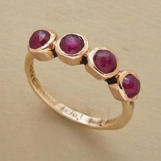 RUBIES IN LOVE RING--Rubies spell out LOVE, one letter inscribed on each 14kt rose gold bezel. Hammered band of 14kt yellow gold. Exclusive, handcrafted by Jes MaHarry in USA. The color of rubies will vary. Whole sizes 5 to 9.