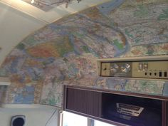 Decoupage map on end cap of Airstream