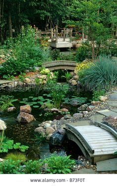 Cedar deck and bridges over ponds in Minnesota water garden