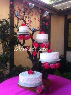 Floral quinceañera cake on tree stand. Visit us Facebook.com/marissa'scake or www.elmanjarperuano.com