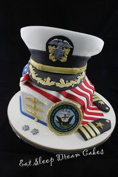 "By Eat Sleep Dream Cakes via Flickr    2011 - A cake to celebrate a US naval Officer's promotion to Commander.  11"" & 7"" base cakes with a carved 9"" and 7"" cake cap. All mud cake with Dark Chocolate Ganache"
