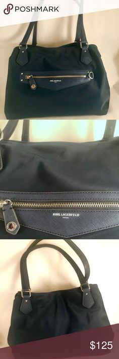 Navy Karl Lagerfeld Bag A beautiful Karl Lagerfeld Bag that has so many good compartments and easy access when you need it but also more secure compartments for your more valued items that would be in your everyday bag you use. It's big but not too big. If you'd like measurements just ask!! Karl Lagerfeld Bags Shoulder Bags
