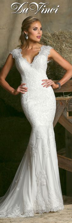 DaVinci Bridal Style # 50320 Lace fit and flare gown features a scalloped V neckline and lace cap sleeves.  High back is accented with lace detail and button closures extending to a zipper.   Chapel length train. http://www.davincibridal.com/