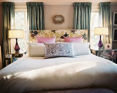 Eclectic Traditional Bedroom: Green curtains and an upholstered floral headboard with white bedding.