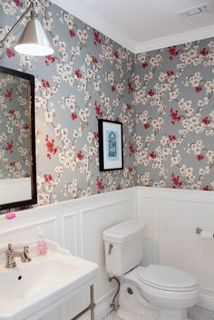 Wainscoting and Wallpaper make for a beautiful bathroom