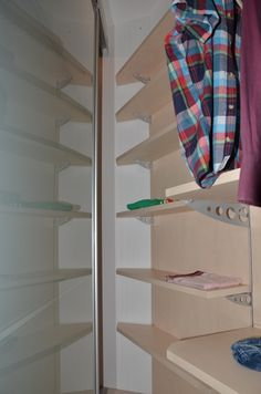 Walk-in closet with birch shelves and cladding.