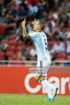 Leandro Paredes of Argentina (R) celebrates his score during the International Test match between Argentina and Singapore at National Stadium on June 2017 in Singapore. Singapore Photos, Soccer Pictures, National Stadium, June, Stock Photos, Celebrities, Sports, Image, Buenos Aires Argentina