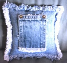 Denim Pillow: How about making pillows out of old denim? Follow the instructions to make one - link.