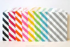 "Cute diagonal stripe favor bags in itty bitty size, but big on uses - Treat bags - Favor bags at weddings, showers or birthday parties - Scrapbooking - Product packaging - Gift wrapping - Gift cards and business cards fit perfectly - Organize small paper scraps, ribbon, stickers, etc.   2.75 x 4"" Kraft paper Food Safe Semi-opaque Bio-degradable Recyclable Made in the USA $5.00"