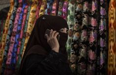 A Uyghur woman wears a veil as she shops at a local market on August 2014 in Kashgar, Xinjiang Uyghur Autonomous Region, China. Black Sea, Atheism, Public Transport, Muslim, Baseball Hats, Women Wear, China, American, How To Wear