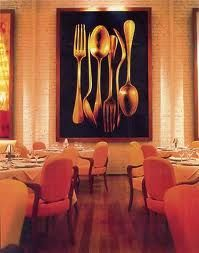 Our back more formal seating area hosts a huge painting of cubiertos (silverware)....