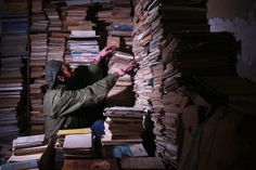 Hamzeh AlMaaytah in his bookstore's storage room.