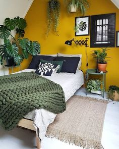 25 Easy Ways To Add Yellow Your Bedroom A Mustard Accent Wall And Touches Of Dark Green Potted Plants Make Up Bold Boho E