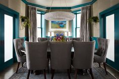 The dining room is full of unexpected accents from the teal wainscoting to the gray grasscloth. Guin and Cory are both in love with the Halo Chandelier from Restoration Hardware, which gently reflects off of the silvery ceiling.