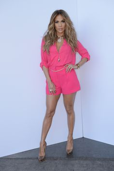 Jennifer Lopez wearing Ivy Kirzhner Pyramid pumps Jennifer Lopez Solid Roll-Tab Crepe Romper in Pink Givenchy Shark Tooth necklace