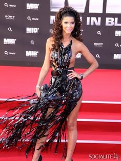 Micaela Schaefer, wearing what looks to be a shredded garbage bag with side boob exposure, attended the German premiere of 'Men In Black 3'