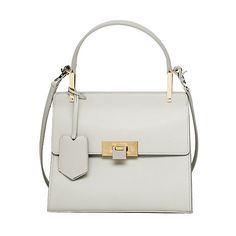 White + Gold. Modern + Timeless. Chic. Simple. Luxe. Square-ish. All impeccable elements of design, married in this Bag by Balenciaga