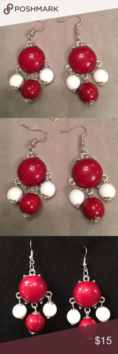 """Pierced Earrings red and white Pierced Earrings red and white.  Never been worn.  Approximately 2 1/4"""" long x 1 1/4"""" wide. Jewelry Earrings"""